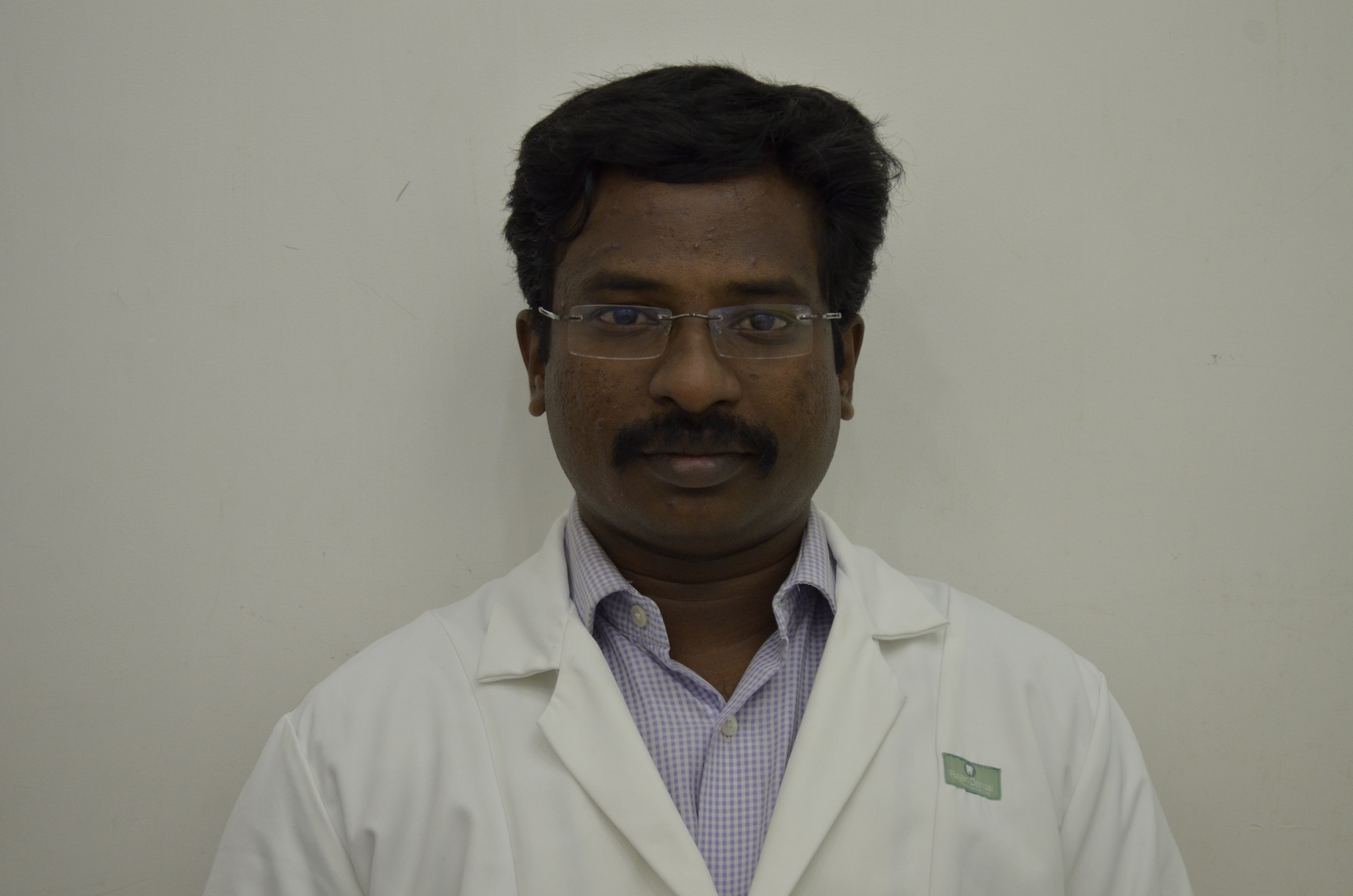 Dr. Anand B