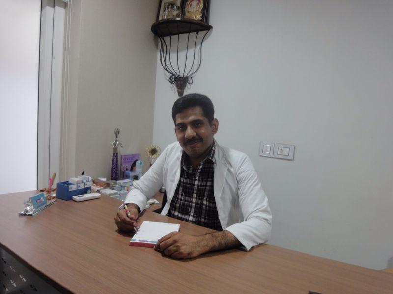 Dr. Chandan A