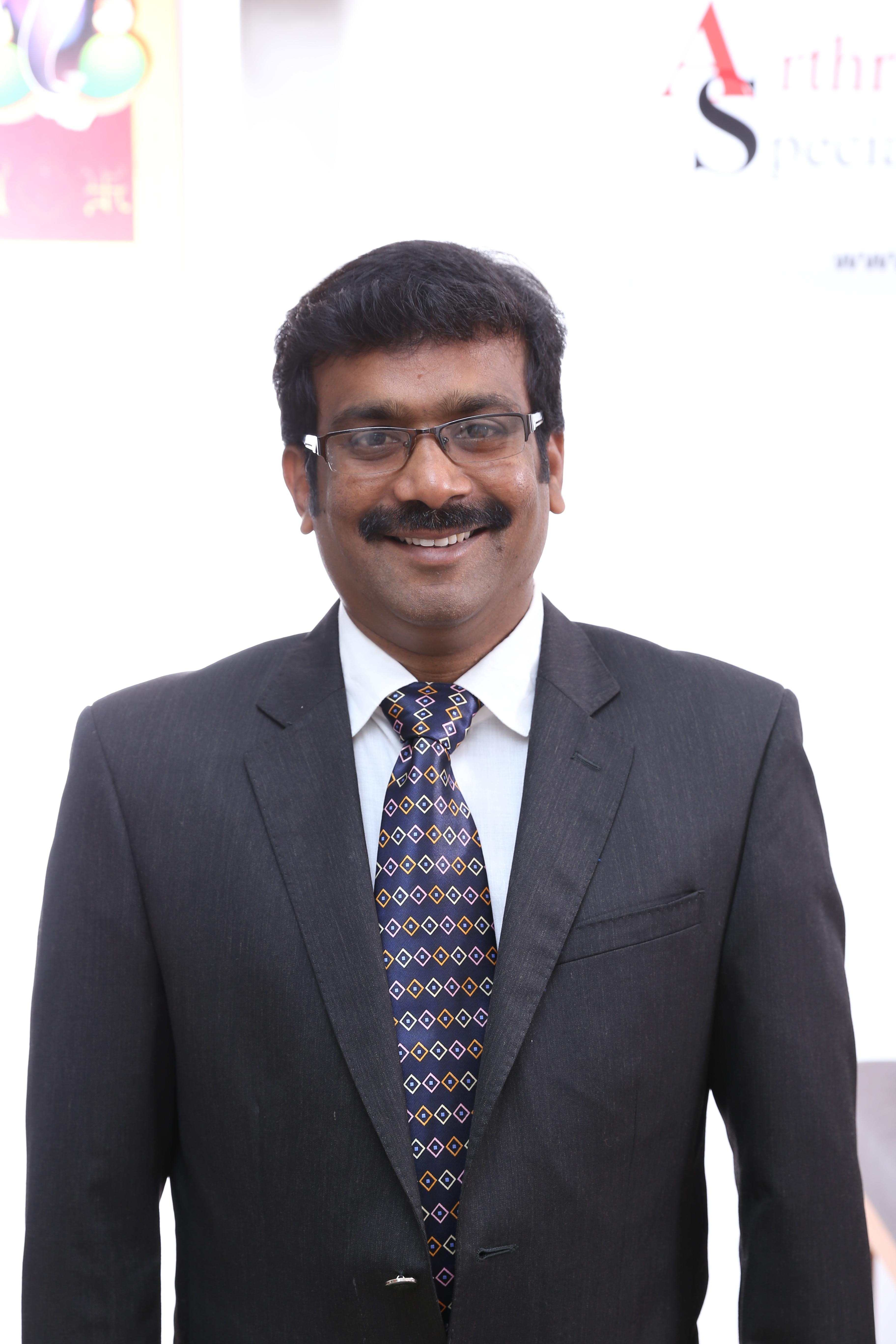 Dr. Dharmesh Kubendiran